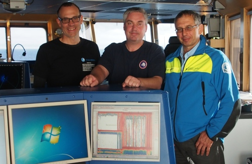Örjan Gustafsson Chief Scientist (Stockholm University), Captain Mattias Pettersson and Igor Semiletov, POI, Vladivostok on bridge with methane flare on screen. Photo: Jorien Vonk