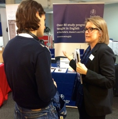 Helene Komlos Grill, Project Manager for International Communications, speaks to a visitor to the Universitys booth at the QS educational fare.